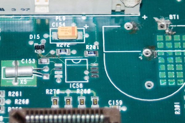 The damaged CMOS/RTC circuit after its initial clean