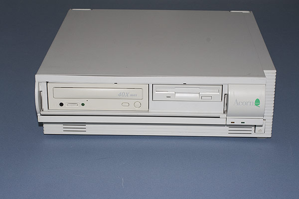 The RiscPC with the front panel opened revealing the 1.44MB floppy drive and CD-ROM drive.