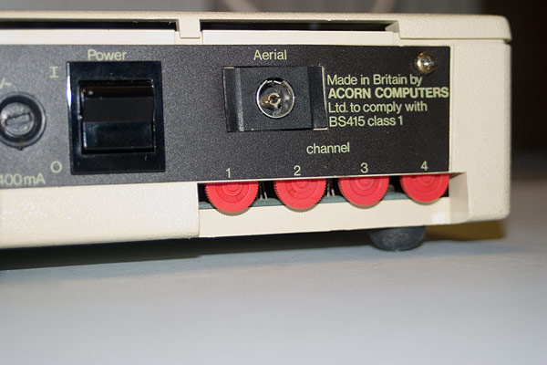 The rear aspect of the Acorn Teletext adapter detailing the power switch, Aerial socket and four tuning wheels