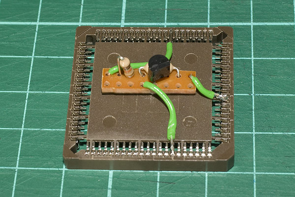 Using an upturned PLCC socket, a small piece of Vero-board contains the reset circuit